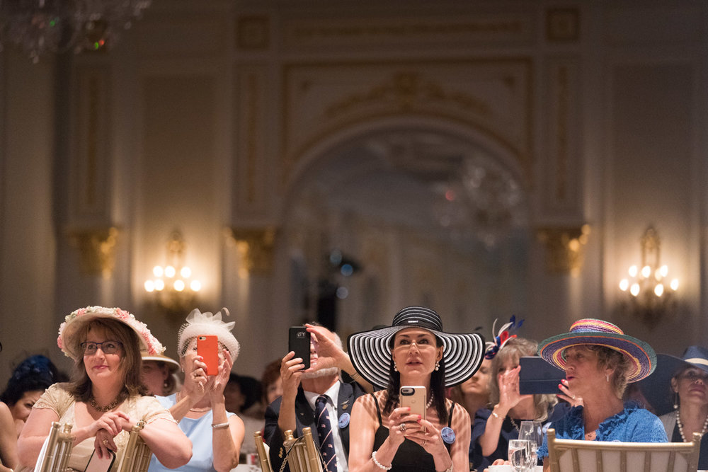 Guests at the Tea for Trump Birthday Extravaganza watch a fashion show at the Trump Hotel in Washington, DC on June 24, 2018.