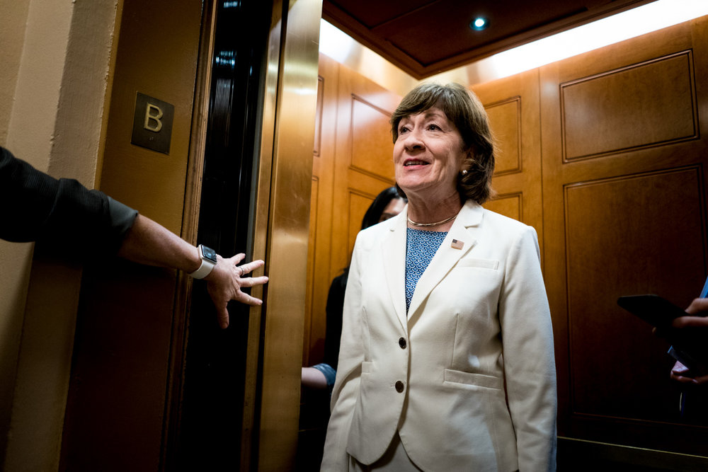Senator Susan Collins (R-ME) speaks to reporters while en route to a vote on Capitol Hill in Washington, DC on July 16, 2018. (Erin Schaff for The New York Times)