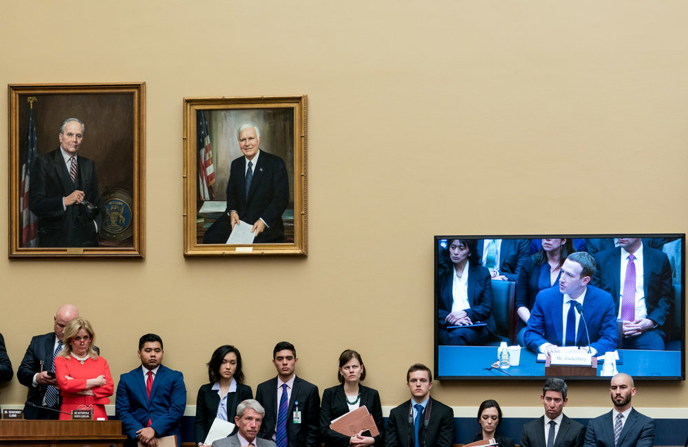Rep. Debbie Dingell (D-MI) and staffers watch as Facebook CEO Mark Zuckerberg testifies before the House Energy and Commerce Committee on April 11, 2018. (Photo for UPI)