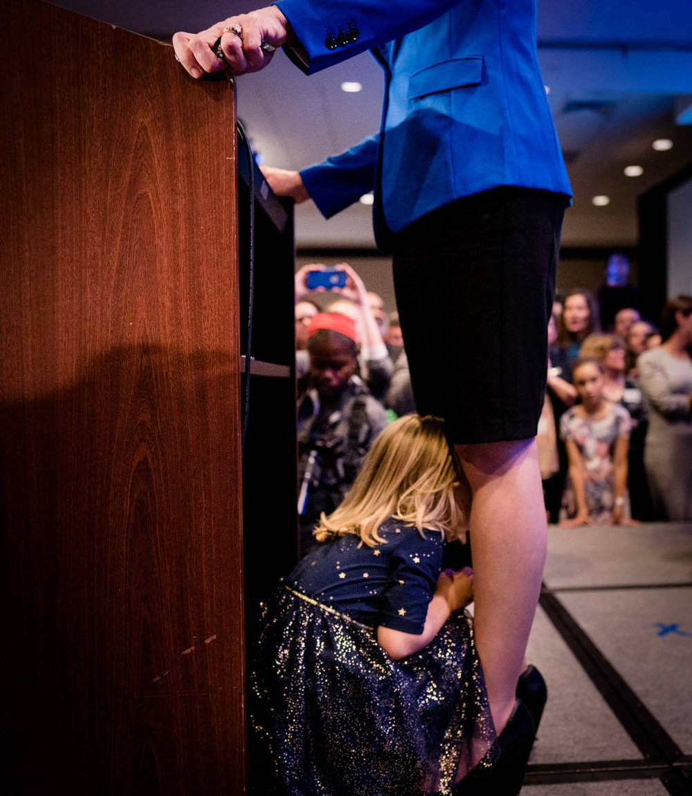 Abigail Spanberger gives her victory speech as her daughter Catherine, age 4, crawls between her legs after winning Virginia's 7th District congressional seat as a Democrat, at the Westin in Richmond, VA on November 6, 2018.