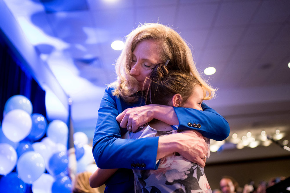 Abigail Spanberger, hugs a young supporter after giving her victory speech at an election night party after winning Virginia's 7th District congressional seat as a Democrat, at the Westin in Richmond, VA on November 6, 2018.