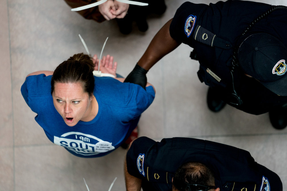 "Capitol police arrest Tiffany Campbell and other demonstrators as they chant ""We believe Anita Hill, we believe Christine Ford,"" outside Senate Judiciary Chairman Chuck Grassley's office on Capitol Hill in Washington, DC on September 20, 2018. Protests and arrests were a constant presence during Judge Brett Kavanaugh's confirmation process."