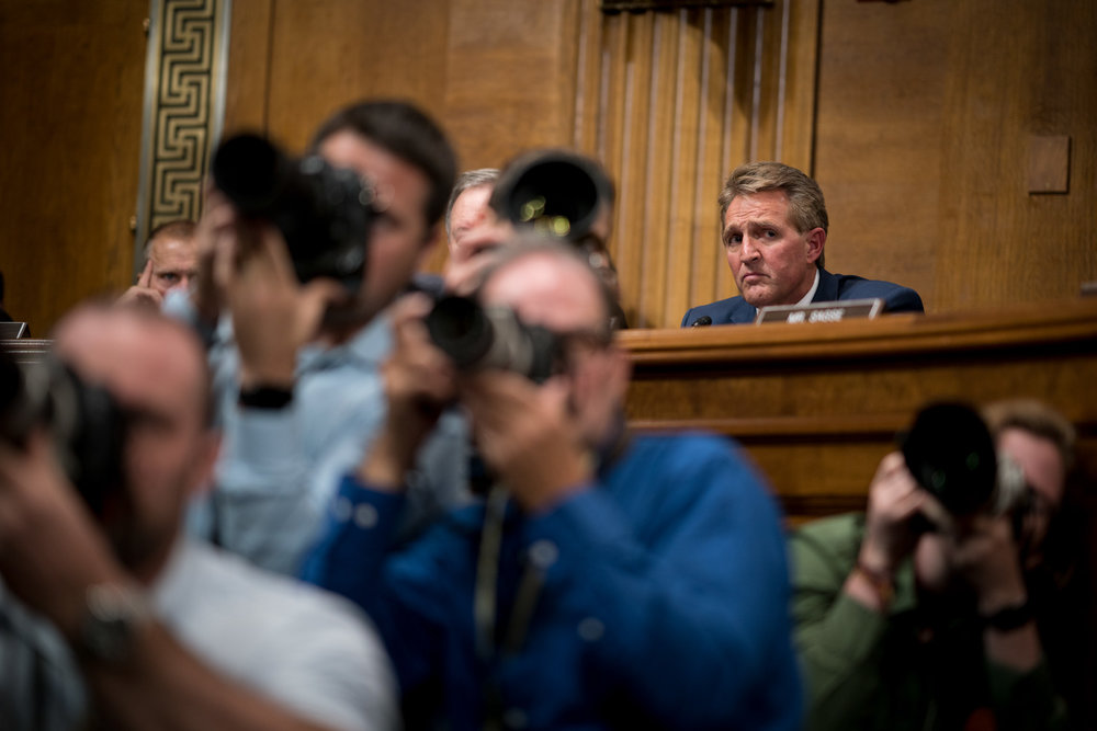 Senator Jeff Flake (R-AZ) sits just after announcing that he would not vote to confirm Judge Brett Kavanaugh to the Supreme Court without an FBI investigation during a Senate Judiciary Committee executive session on Capitol Hill in Washington, DC on September 28, 2018.