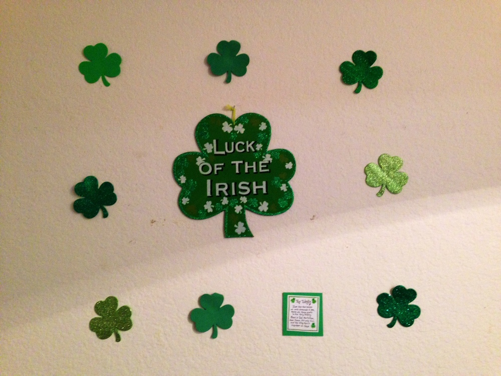 Shamrock wall with trinity inscription. I think the wall would look better without that random mounted paper I made, but I wanted the description to be present.