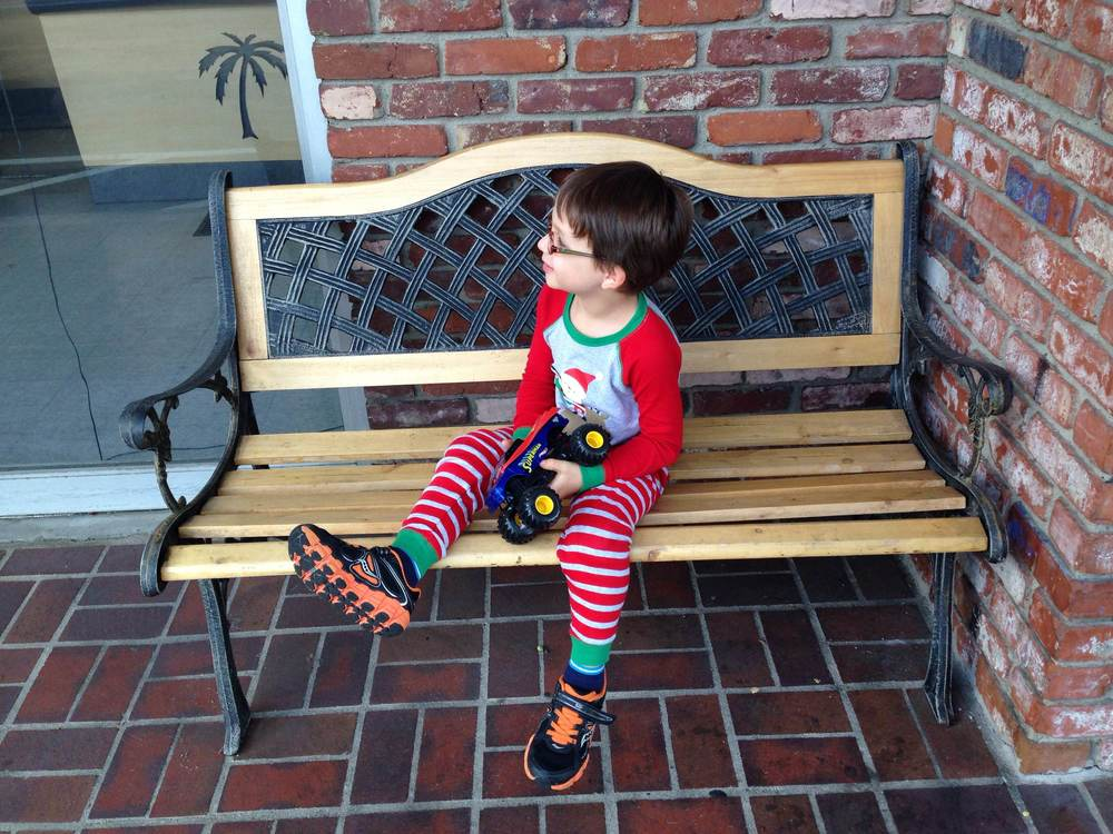 After a mere minute of being at the cleaners, Caleb was bored. Please child, the world does not need to entertain you. The bench sufficed for his waiting pleasure as I finished up with the drop off. Seriously, quick errands are a known bigger ordeal with kids involved.