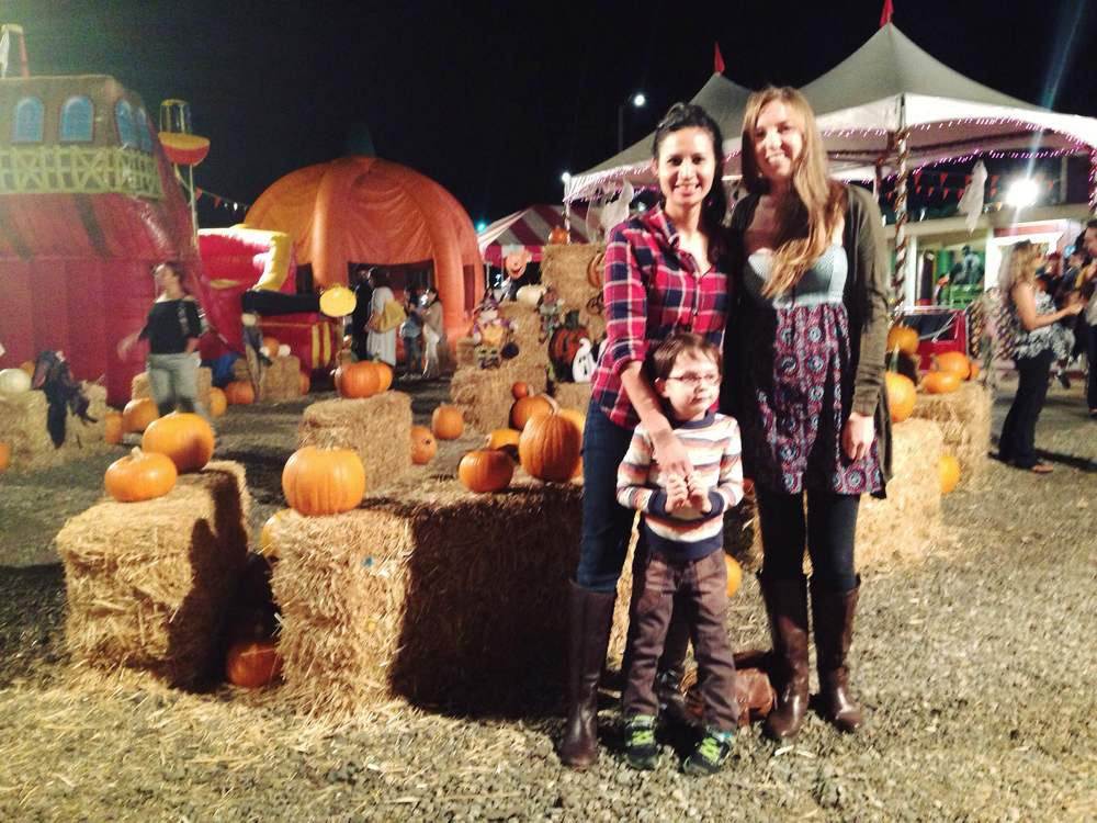 Photo taken today at a pumpkin patch of Kaitlin, C, & I. C is eyeing where to bolt next.