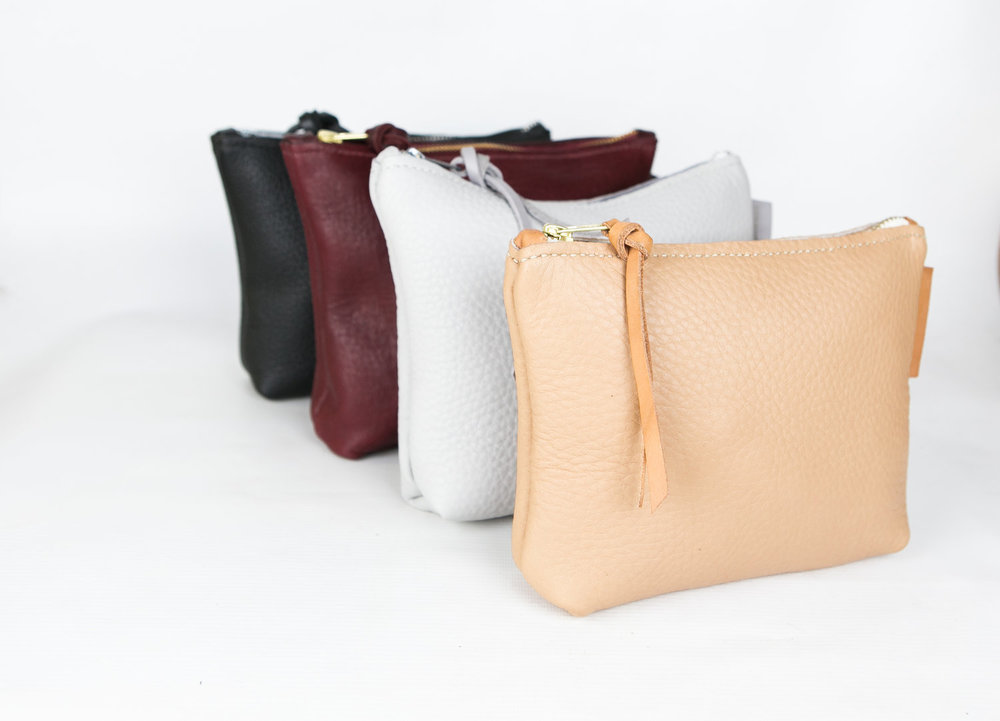 Toiletry Zip Case in black, deep wine, brown, slate grey, and natural.