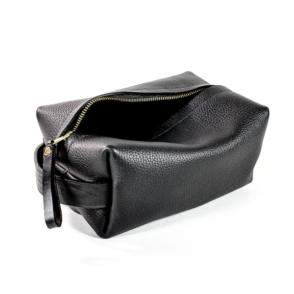 Minnie + George for Portland Razor Co. Buffalo Hide Dopp Kit in black.