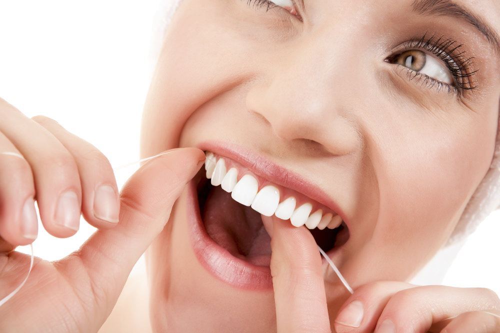 woman-flossing-close-up-oral-health.jpg