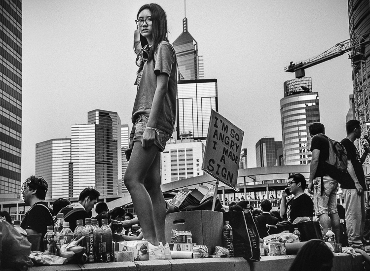 (c) Harriet Dedman 2015. Photograph of Isabelle Cheung, 18, at the Admiralty Protest Sites on 28 September 2014.