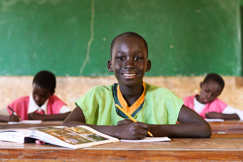This photo of a boy sitting in his classroom, is part of the Commerce and Culture stock program. The workshop in Bamako in April 2011 is focusing on all the new equipment that the school has received.