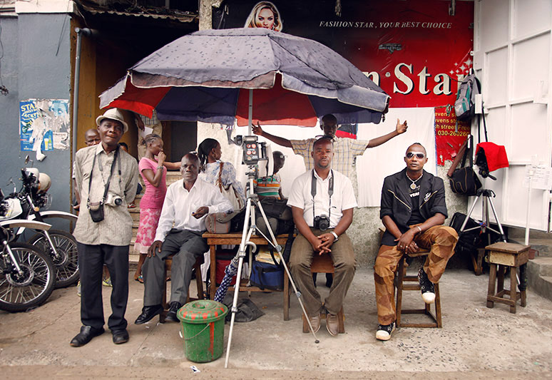 Freetown photographers waiting for customers outside a Lab in Sierra Leone.