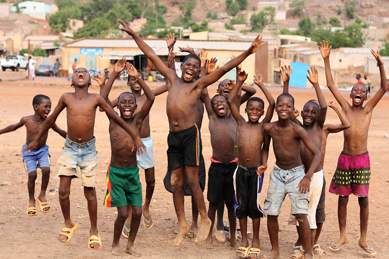 Photo of boys jumping and smiling by stock photographer Aboubacar Traore was the first picture sold through Getty Images. Commerce & Culture celebrated together with Aboubacar Traore the first sale.