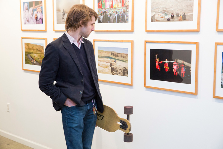 commerce-and-culture-afghan-tales-opening-night-munch-gallery-man-looking-longboard.jpg