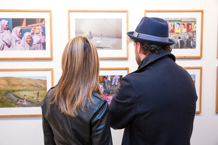 commerce-and-culture-afghan-tales-opening-night-munch-gallery-man-woman-looking-photos.jpg