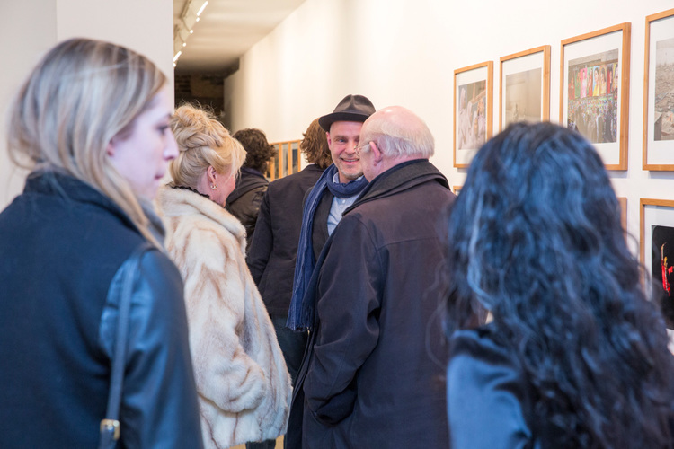 commerce-and-culture-afghan-tales-opening-night-munch-gallery-partner-thomas-damgaard-talking-couple.jpg