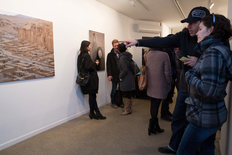 commerce-and-culture-afghan-tales-opening-night-munch-gallery-room-overview-man-pointing.jpg