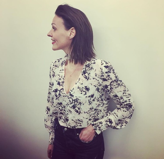 SURANNE JONES WEARING FASHION DESIGNER ELLIE LINES SILK TORI BLOUSE