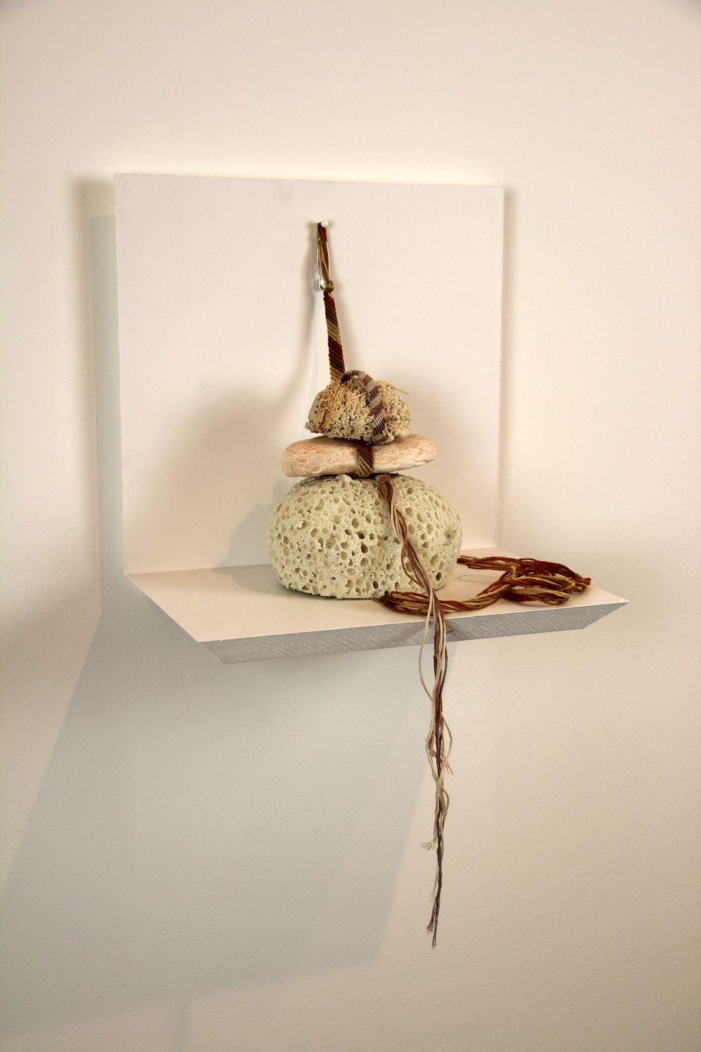 "hush.     porcelain, embroidery thread, safety pin. 10 x 10 x 7"". 2011"