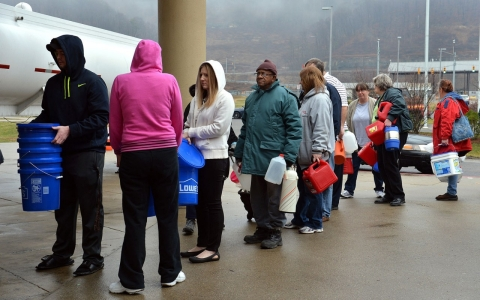 West Virginia residents line up to fill containers with clean water after Elk River chemical spill in 2014.