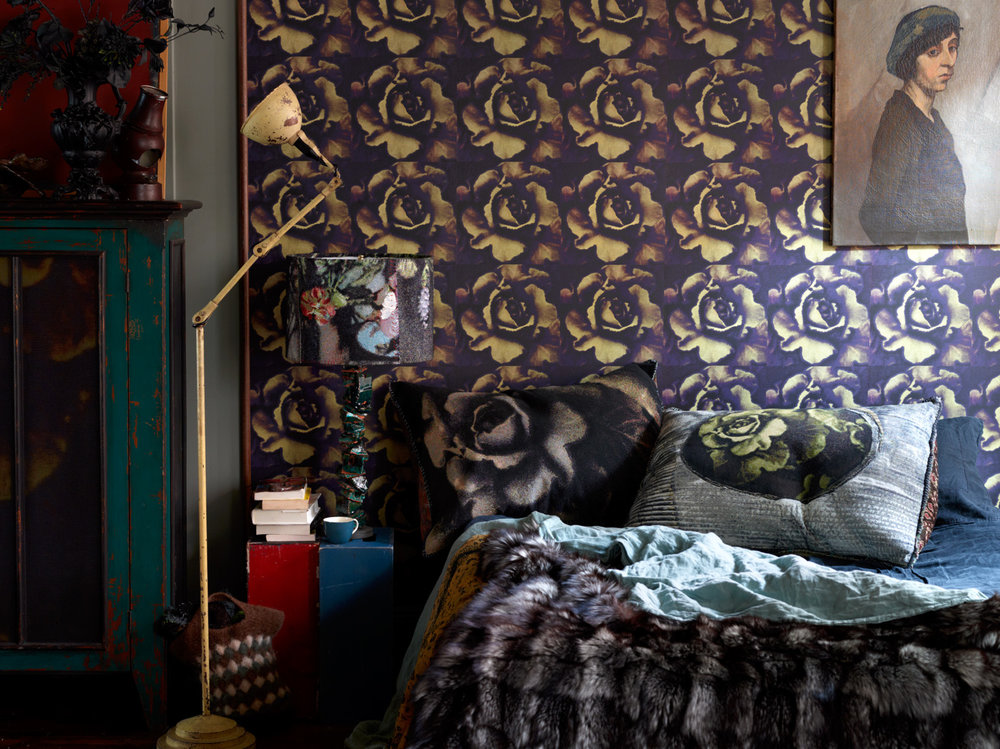 """Melting Midnight"" wallpaper and bed with King Euro tapestry pillows, alongside a ceramic ""Quarry"" lamp by MTS and Dove Drury Hornbuckle."