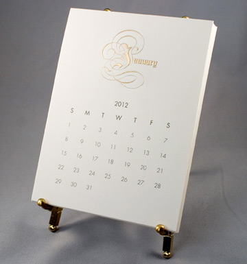 Engraved gilded script lavishly enhances dempsey and carrolls desktop easel calendar it adds a bit of formality and is a great gift for a work friend