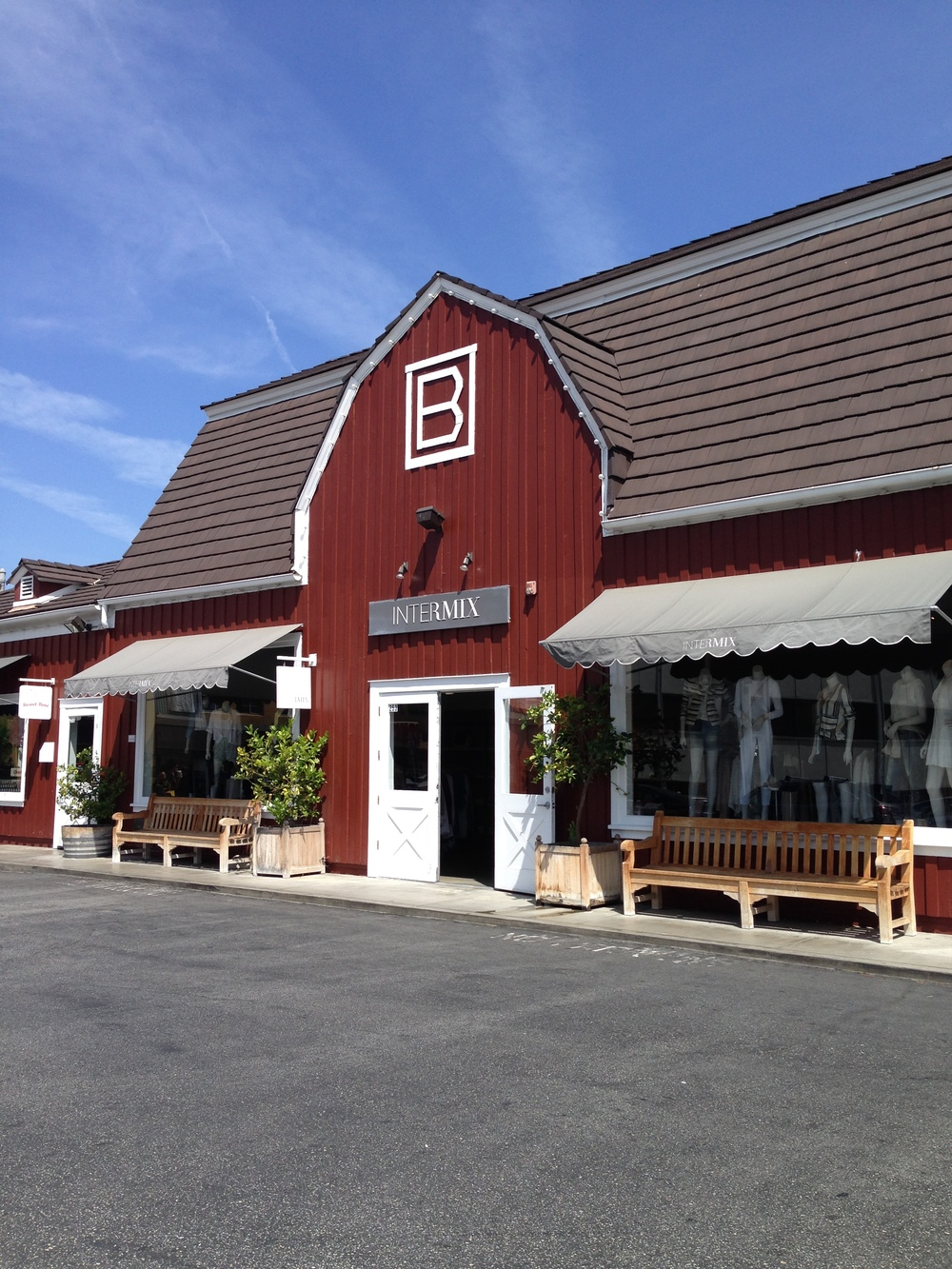 The entrance to the Brentwood Country Mart, a red and white retail barn space that has been in existence since the late 1940's. Filled with a rotation of the best small boutiques, from Calypso to Turpan Home, the homey feel of the space is evident in its steeped-in-charm facade