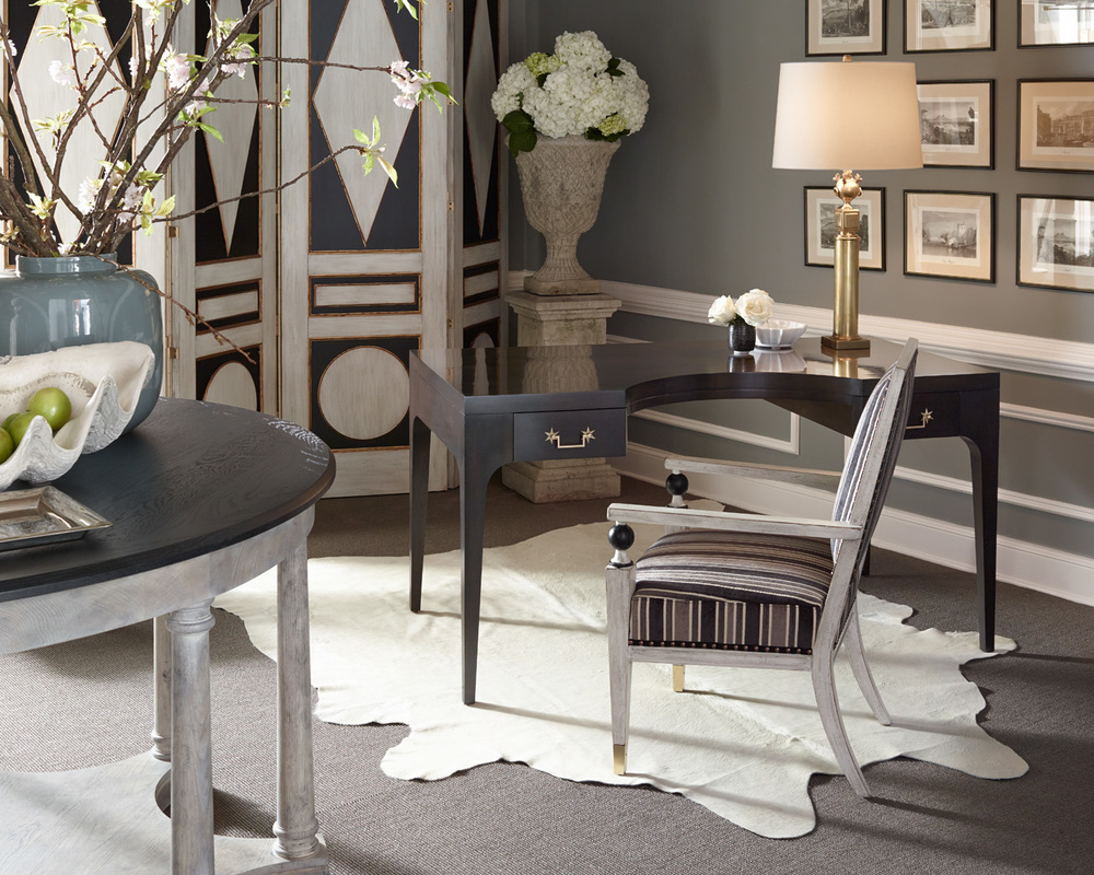 Light white finishes paired with black details and a bit of brass channel French salons of yore, with the Malmaison Folding Screen, curved writing desk and Drayton Center Table with star base