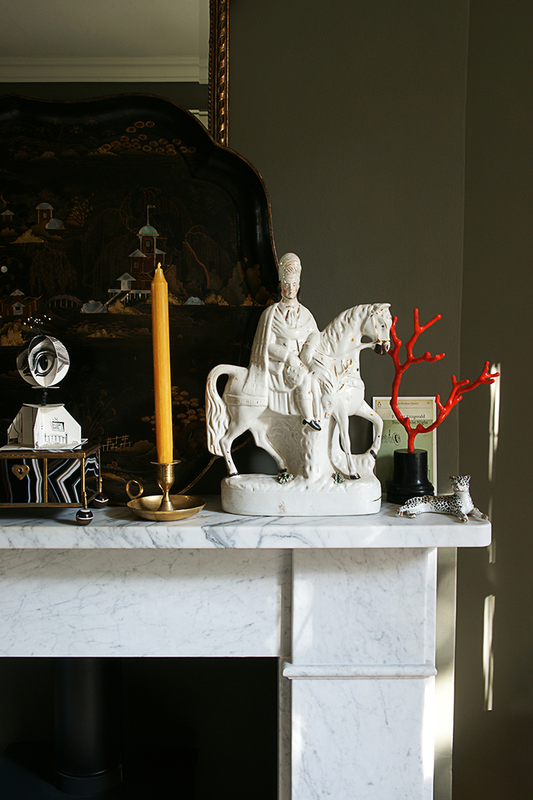 A marble mantel styled with beautiful objet for Christies London
