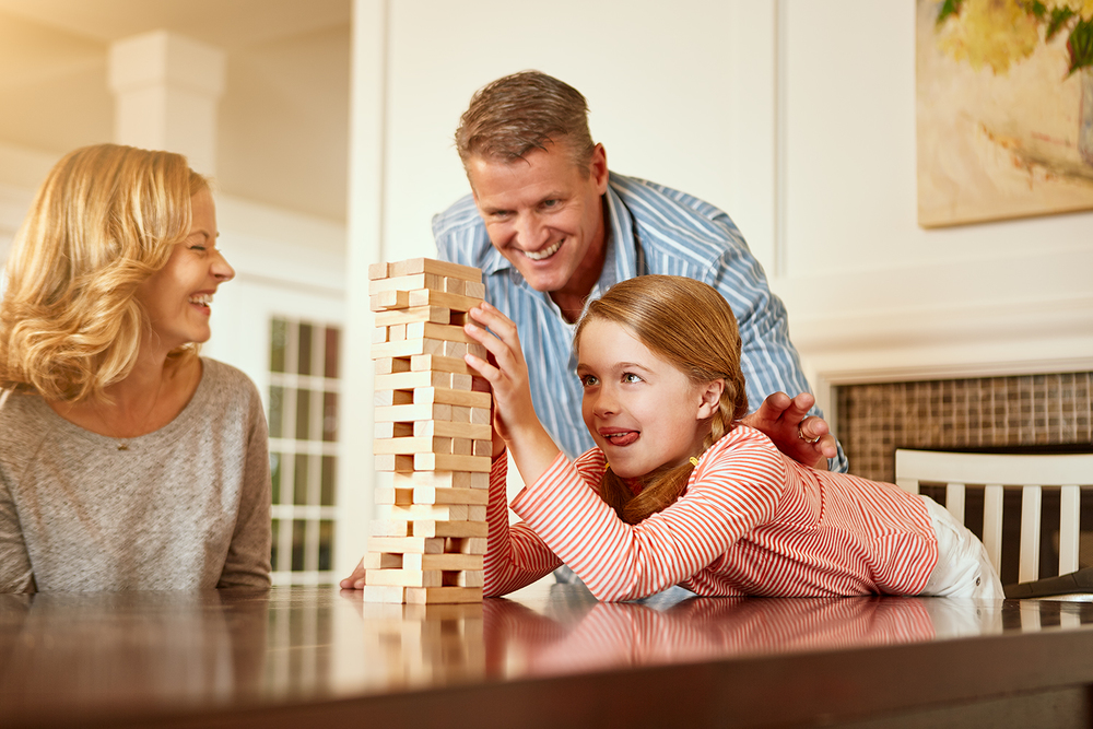 family playing game on table indoors.jpg
