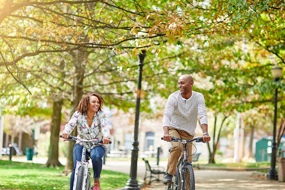 man and woman riding bikes in park.jpg