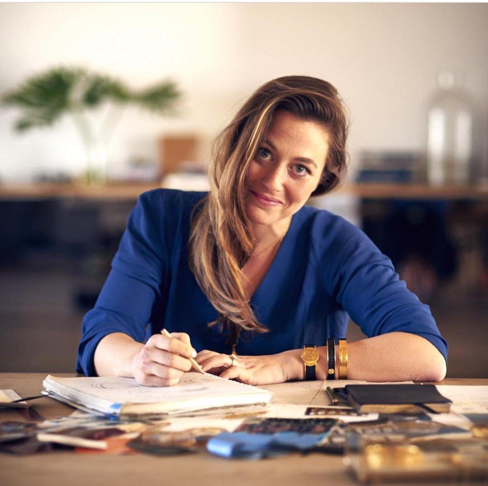 Kyle Garcia, Founder & Designer at her desk