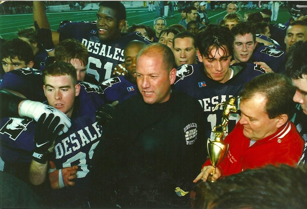Head Coach Bob Jacoby being presented the championship trophy