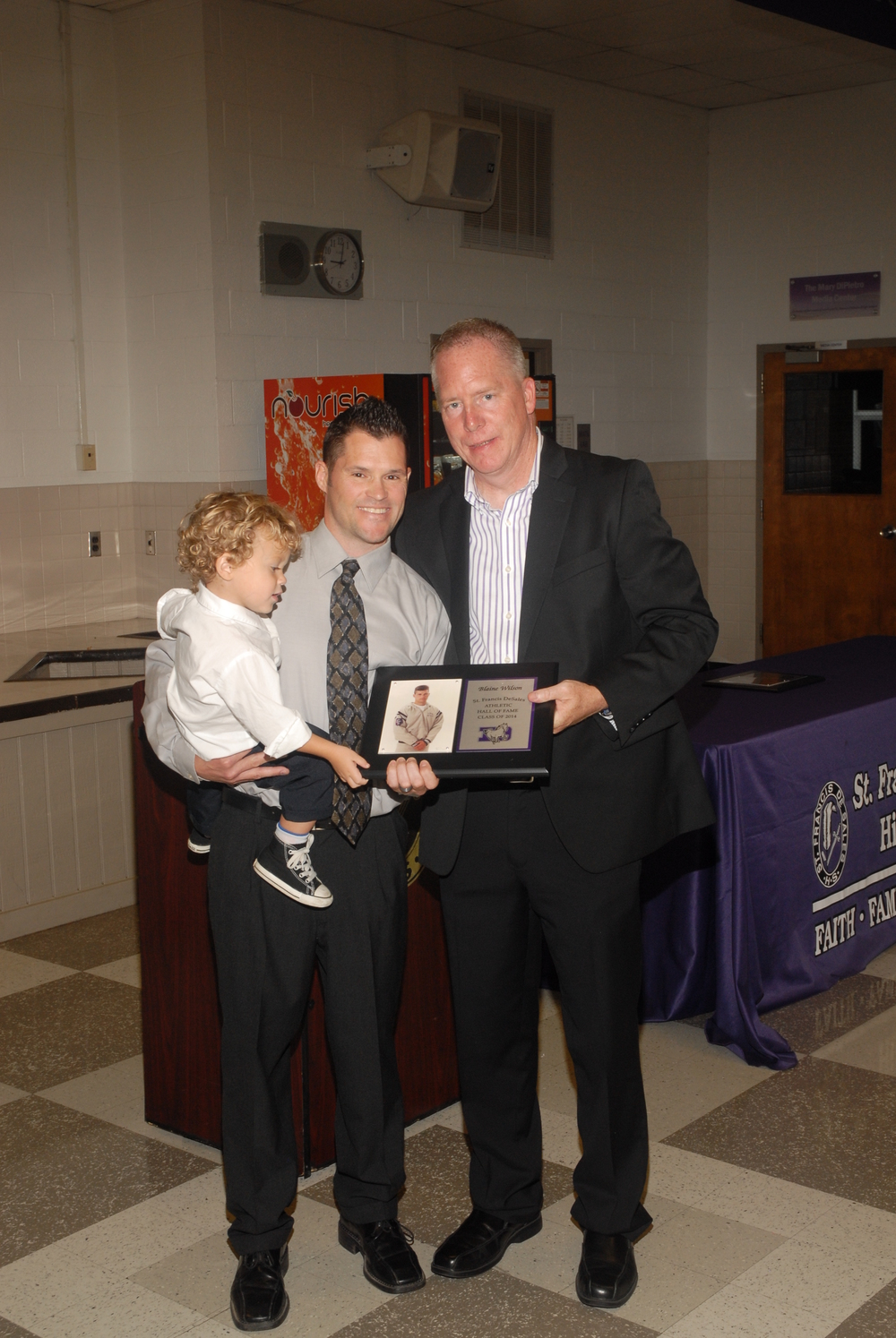 Blaine Wilson, his son and principal Dan Garrick