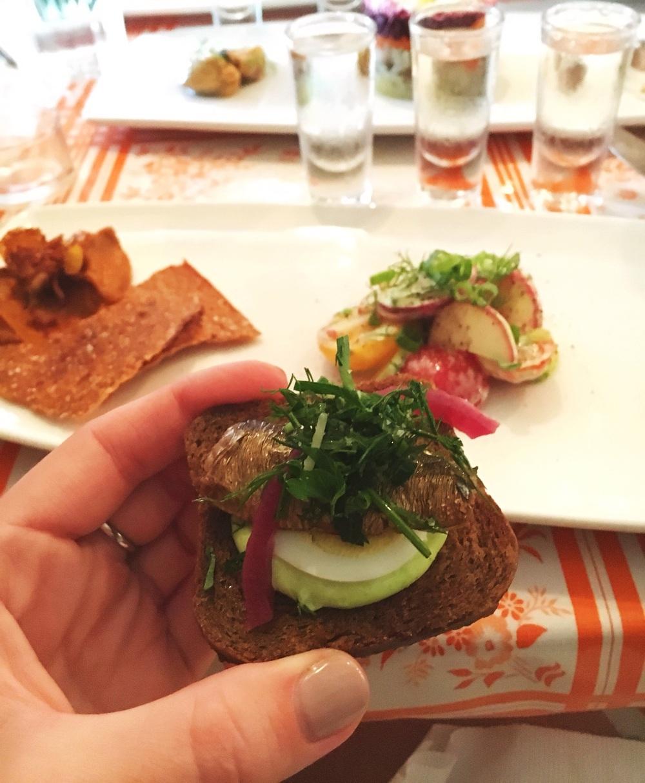 Baltic sprat buterbrodi -tiny smoked fish, parsley mayo, pumpernickel toast.