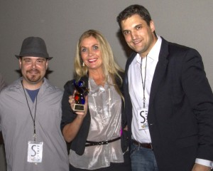 Faith Hibbs-Clark of Good Faith Casting receives the first Barry E Wallace Award at 2012 Filmstock Arizona.
