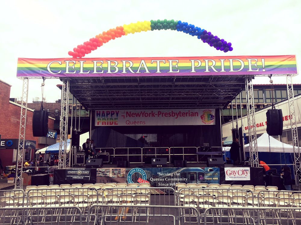 Rainbow balloon arch over festival stage