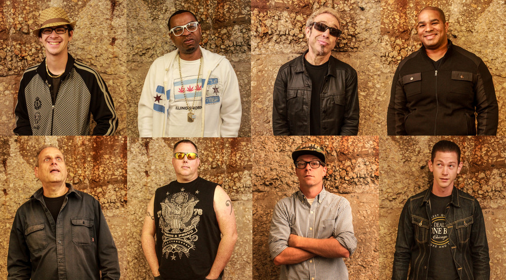 "Top row:  David ""My Boy Elroy"" Arredondo–Turntables & Beatbox // Dirty MF - MC // Mars Williams - Sax // Devin Staples – Drums     Bottom row:  Tom Klein – Guitar // Ricky Showalter – Bass // Brian ""MC B"" Quarles – MC // Doug Corcoran – Trumpet & Keyboards"