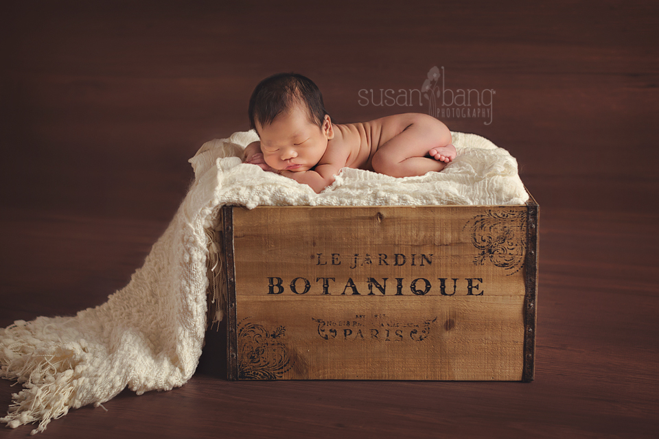 Newborn Baby on wooden crate
