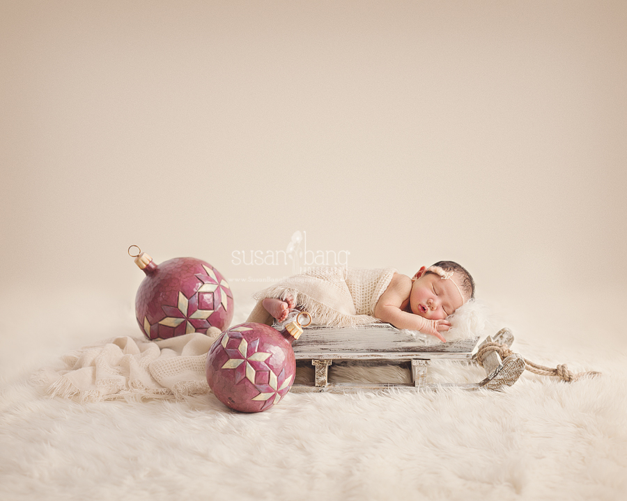 Holiday Newborn Photo with Christmas Ornaments
