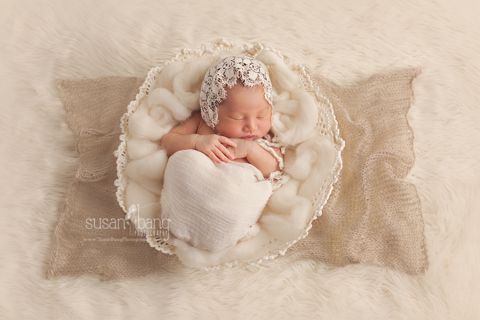 Newborn in doily basket