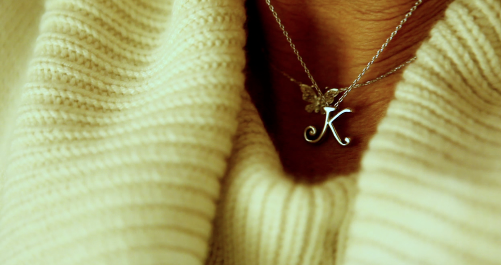 Mary wears a necklace in memory of her daughter Kelly, an organ donor.