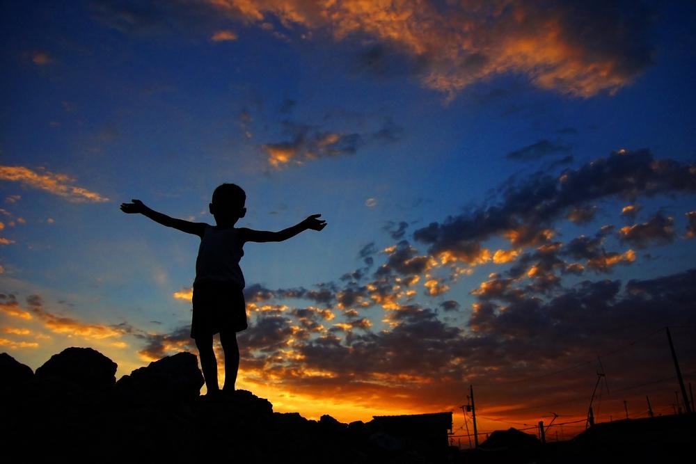 kid in sunset.jpg