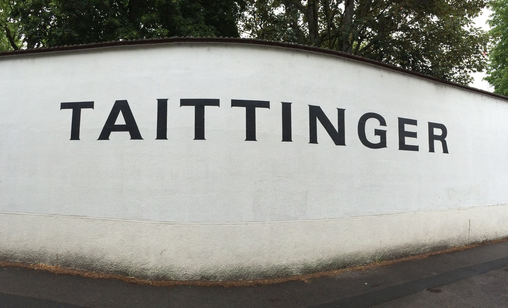 The wall leading up to the gates of Taittinger Champagne House.