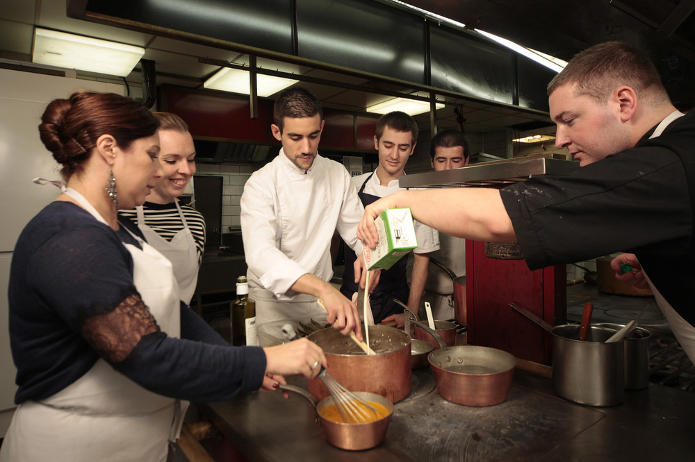 Taking part in Alain Llorca's cooking classes, where guests are taught to cook dishes of the region.