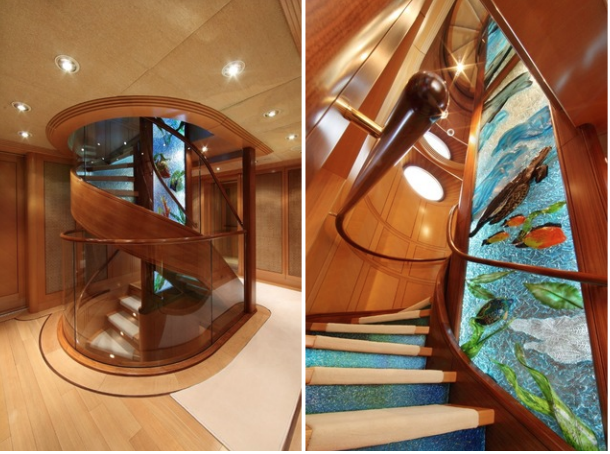 Main Staircase. The yacht's staircase spirals around a three-storey-high glass sculpture depicting marine life, by Seattle artist Mary van Cline.