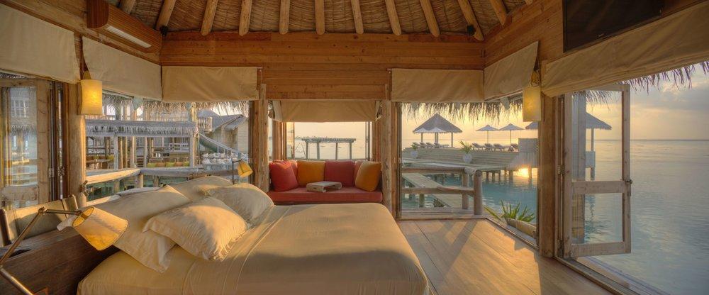 GLM_Private Reserve Master Suite Bedroom at Sunsrise.jpg