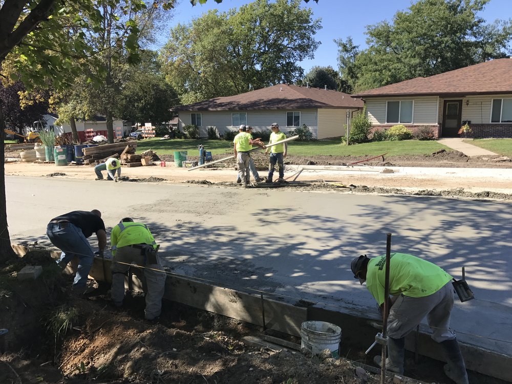 Concrete Crew using their skills to pave roads and install curb &gutter. -