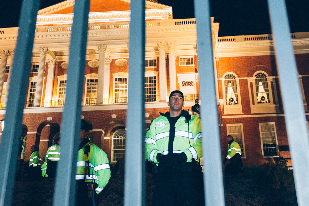 Just beyond the fence blocking the front of the state house was a phalanx of additional state troopers, standing a few feet apart.