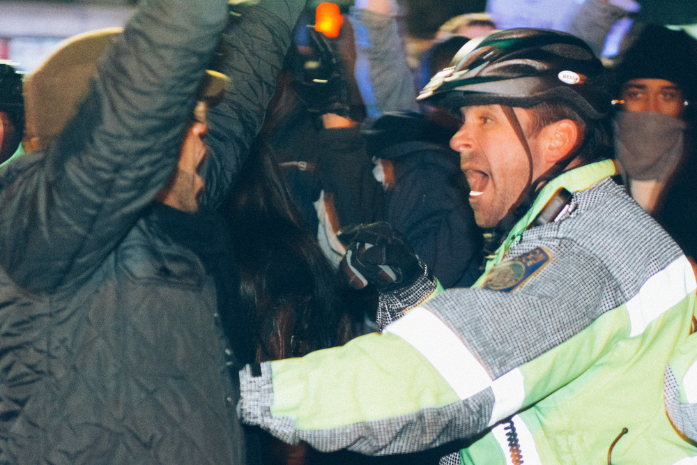 This protester was doing his best to keep others from getting arrested. Shortly after this confrontation, he was pulling protesters off a park police car, keeping them out of jail.